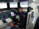 Ms. Barnett piloting the Endeavour space shuttle simulator